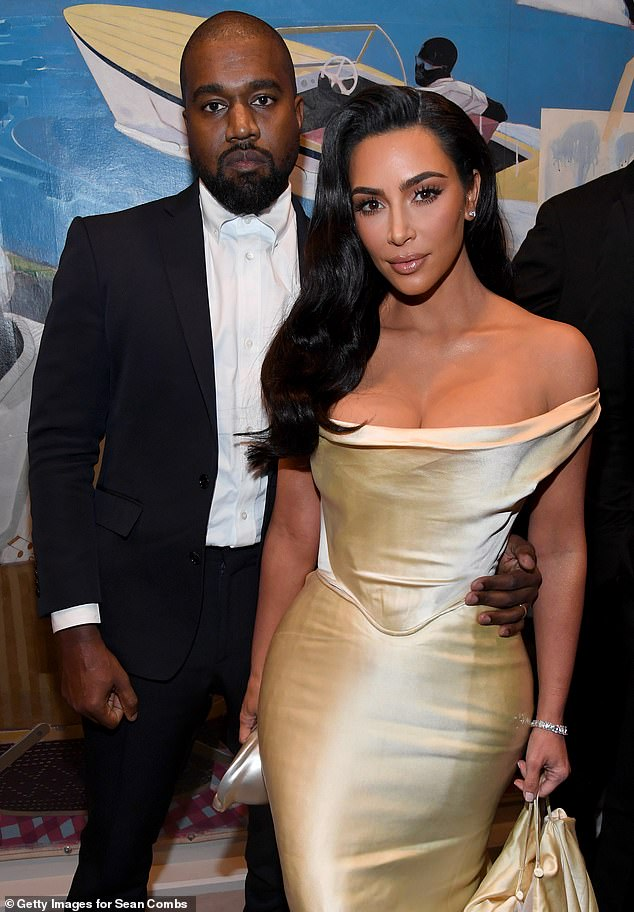Grim future: The pair who have been living apart for months seem to be heading towards divorce despite reported grandiose gestures on Kanye's end with sources saying he is, 'aware the marriage is over' according to E! News; pictured December 2019
