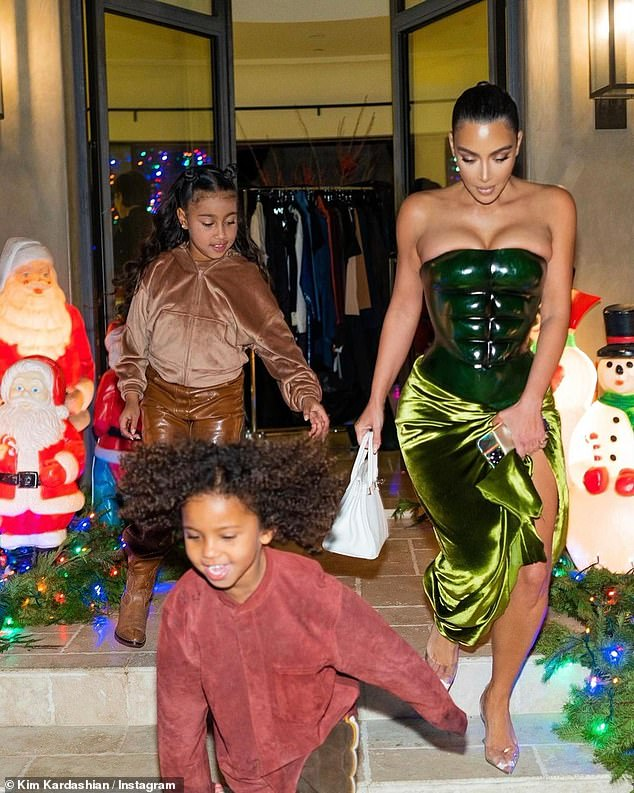 Running wild: Kim has reportedly been the driving force in raising their kids over the past few months despite news that they did indeed celebrate Christmas together; pictured December 25