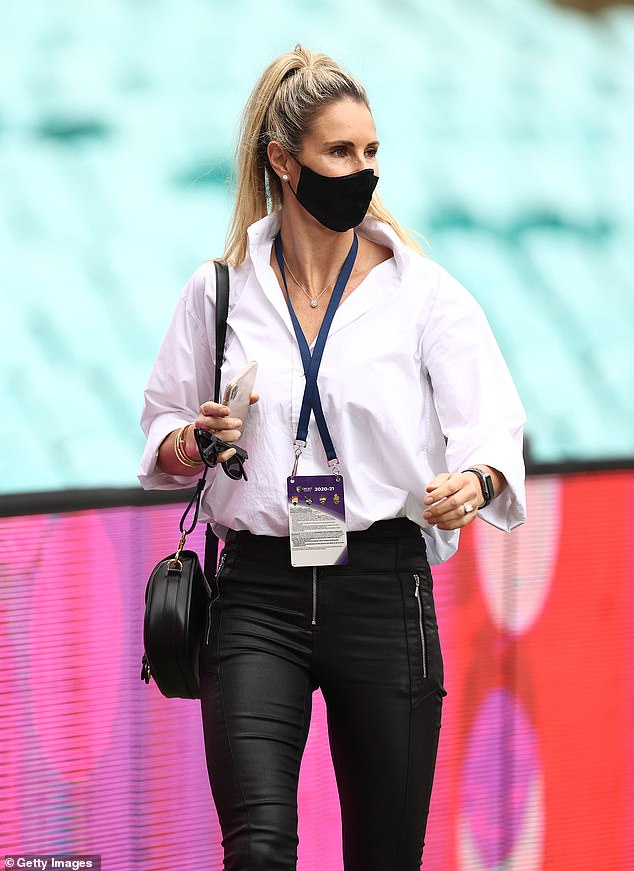Keeping safe: Candice finished her outfit with a face mask, showing a sign of the times