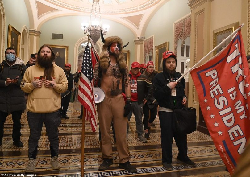 Supporters of Donald Trump are seen inside the US Capitol after rioters breached security and entered
