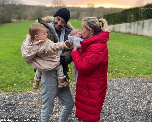 Positive progress: Earlier this year, Tom revealed that his stage 4 brain tumour has 'significantly reduced' and is 'responding well' to treatment (pictured with his family)