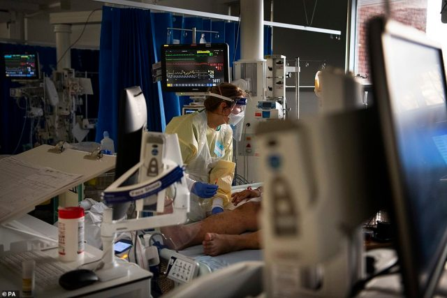 A medic works with a patient in the ICU (Intensive Care Unit) in St George's Hospital in Tooting, south-west London