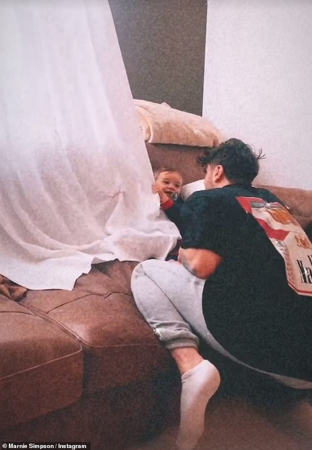 Cute! In a new Instagram clip, their 15-month-old son was seen resting on a leather sofa and holding onto a curtain while Casey dipped his head back and fourth in a game of peekaboo