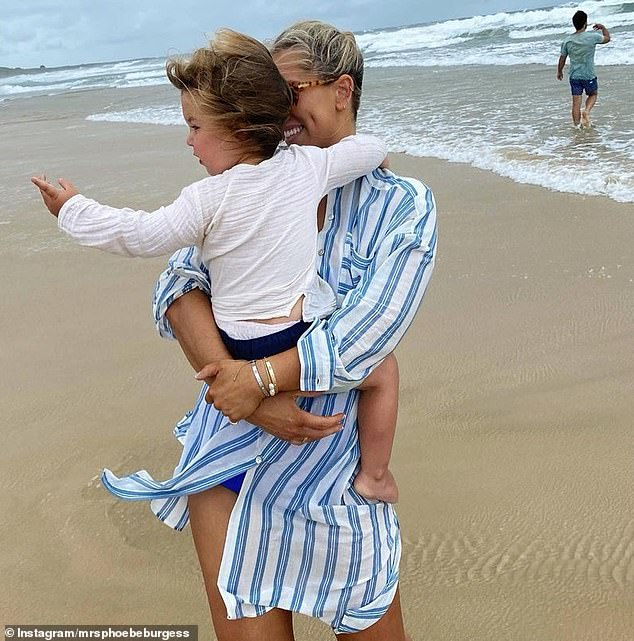 On the road: Phoebe headed to the beach with two young children, daughter Poppy, three, and son Billy, two