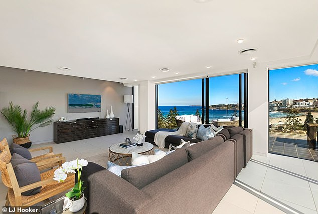 The Bachelor pad: His Bondi unit (pictured) has floor-to-ceiling glass windows that look out to the beach and allow natural light to flood into the living area