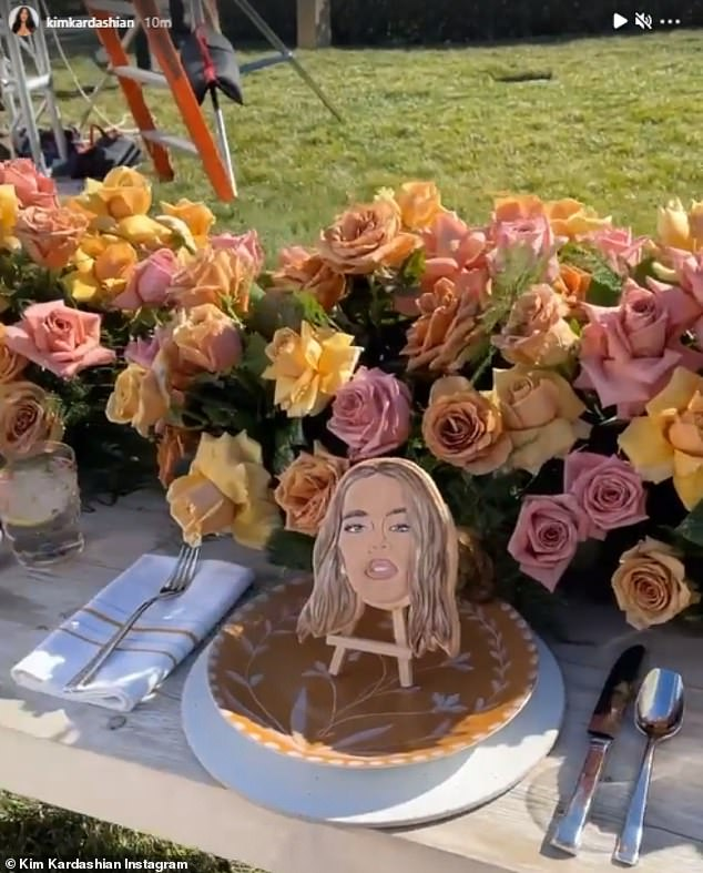 And here's Khloe:The table boasted gorgeous floral arrangements, along with edible cookie place settings showing each famous family member