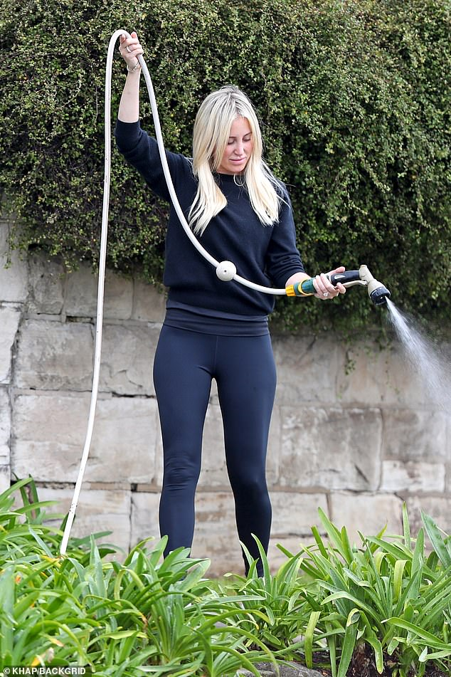 Roxy Jacenko waters the garden outside her Vaucluse mansion