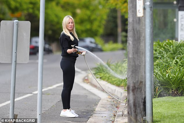Focused: The successful PR maven was focused on watering her lawn