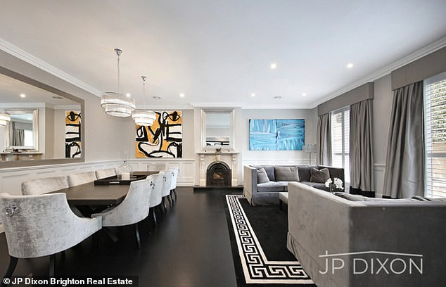 Monochrome chic: Black and white are a consistent colour theme throughout the property, as well as a grand staircase near the entrance