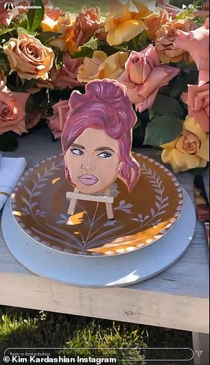 Personalized: She also showed off some cute place settings at their last lunch, each family member's plate featuring a cookie decorated with their face