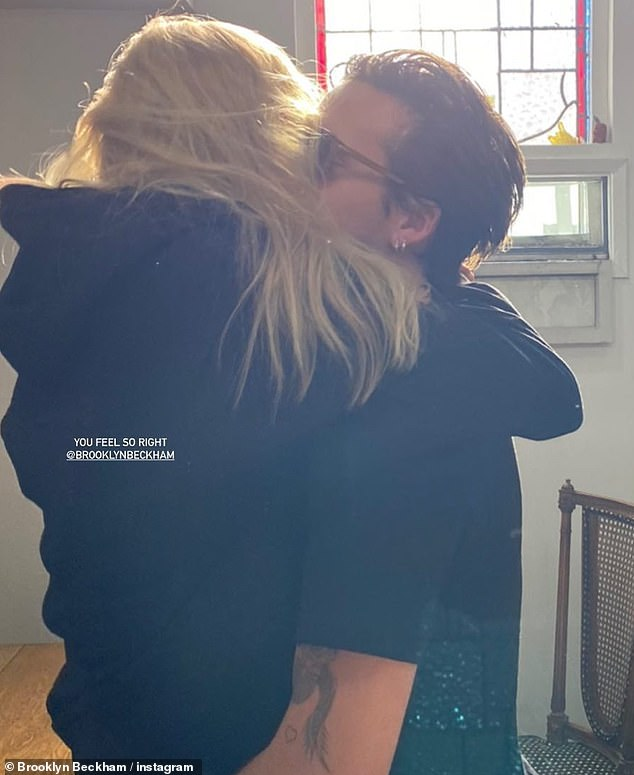 Love: Brooklyn Beckhamwrapped his arm around Nicola Peltz on Friday and planted a kiss on her cheek in an Instagram snapbefore his fiancée rung in her 26th birthday on Saturday