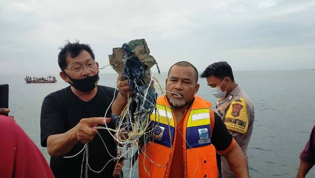 A Sriwijaya Air Boeing 737 passenger jet carrying 62 people has disappeared over the sea after plummeting 10,000 feet shortly after takeoff from Jakarta, reports claim. Pictured: Some suspected debris from the plane found by fisherman