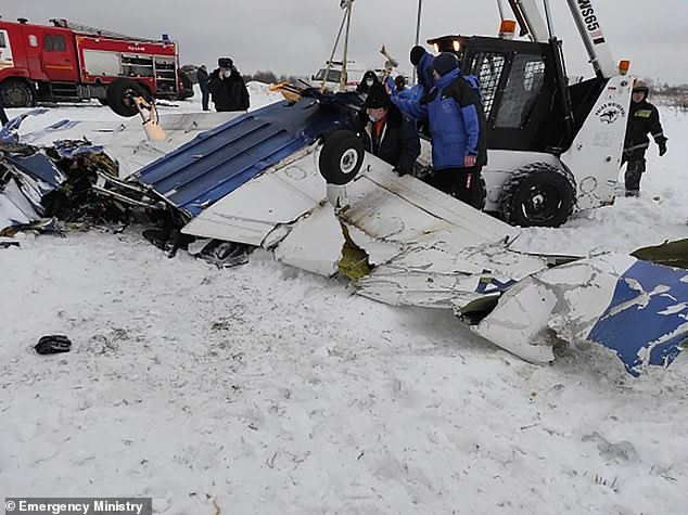 Wreckage of the Piper was strewn in the snow close to Gostilitsy airport after it plummeted to the ground from a height of 1,000ft