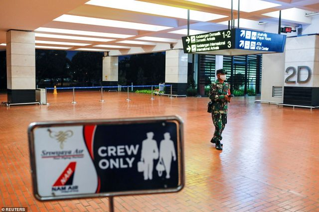 There are feared to be 62 people on the 26-year-old plane, including 56 passengers - seven of whom are children and three are babies - as well as two pilots and four cabin crew. Pictured: Soldiers in Soekarno-Hatta International Airport in Jakarta after the plane lost contact