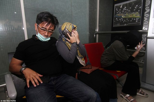 Television footage showed relatives and friends of people aboard the plane weeping, praying and hugging each other as they waited at both Jakarta's airport and Pontianak's airport