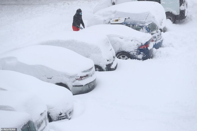 It wasn't just cars trying to traverse the snowy roads in Spain, this line of cars and nearly entirely covered in a thick blanket of snow