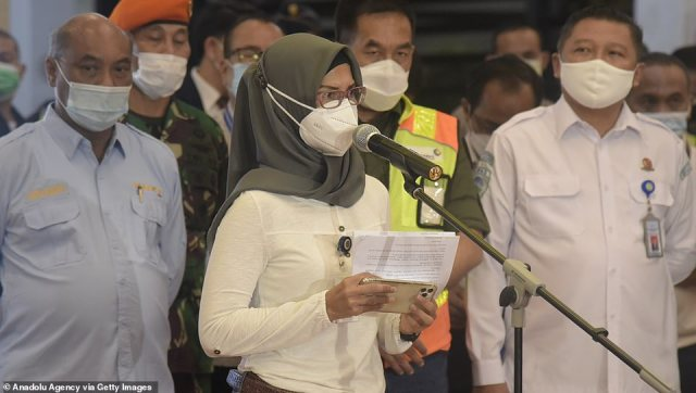 Adita Irawati (centre) - spokesperson for the Indonesian Ministry of Transportation - speaks to the media during a press conference after the plane went missing