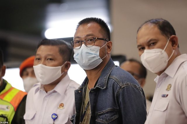 President of Sriwijaya Air Jefferson Jauwena (centre) attends a press conference at the crisis center in Soekarno-Hatta International Airport