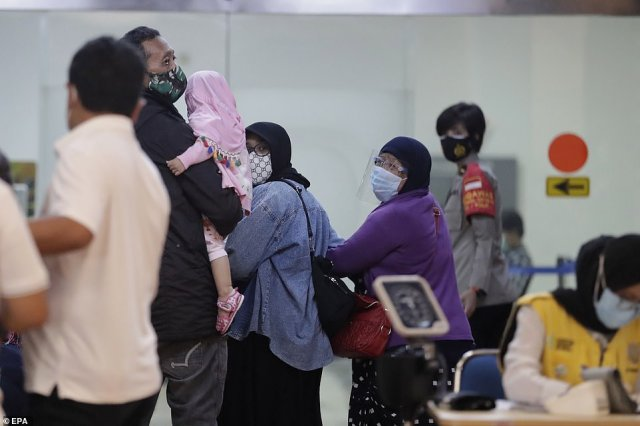 Terrified loved ones of the 62 people feared to be dead after aSriwijaya Air Boeing 737 plane went missing arrived at Soekarno-Hatta International Airport to wait for news