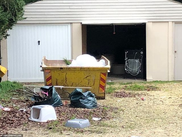 Pictured: Katie's rental house could be seen surrounded by rubbish in the garden and surrounding grounds, with only an overflowing skip attempting to contain some of the mess