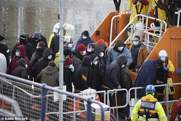 Migrants arrive at the Sovereign Harbour in Eastbourne, East Sussex on Saturday, after a rescue operation was launched to save a boat 'in difficulty'