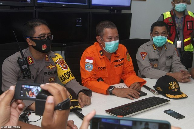 Officials inPontianak in West Kalimantan address the press after the flight - with 62 people on board - went missing over the Java Sea