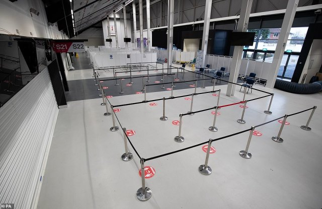 Earlier this week the Prime Minister revealed seven mass coronavirus vaccination centres will open next week to turbo-charge efforts to get jabs to millions of people and pull the UK out of a relentless cycle of lockdowns. Pictured, cordons have been set up ahead of queues of people waiting for the vaccine