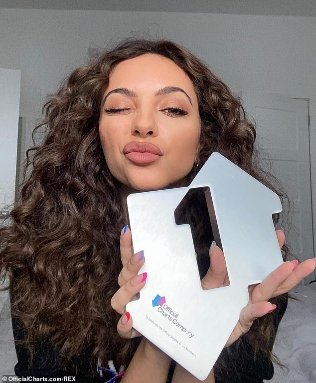 Celebrating: Jade was presented with an award from the Official Charts Company to mark the number one single