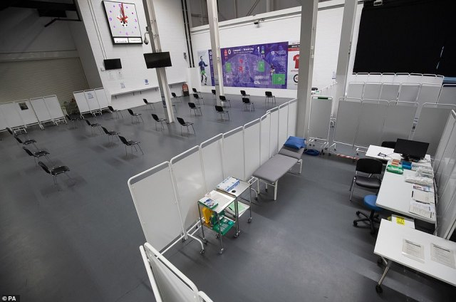Britain recorded more than 1,000 Covid-19 deaths for the fourth day in a row as the new mutation wreaks havoc across the country. Pictured: A vaccination booth next to a waiting area inside Ashton Gate Stadium in Bristol
