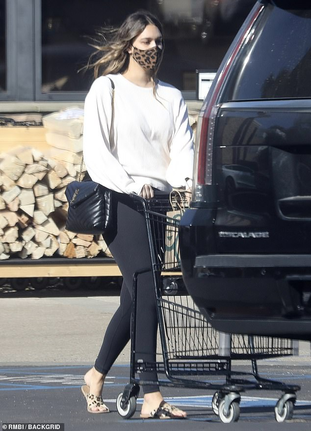 April Love Geary keeps it casual in a white sweatshirt and black leggings as she picks up essentials
