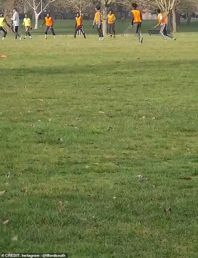 The group of around 25 men were spotted playing a match in Valentine's Park, Ilford, in the London Borough of Redbridge on Saturday morning