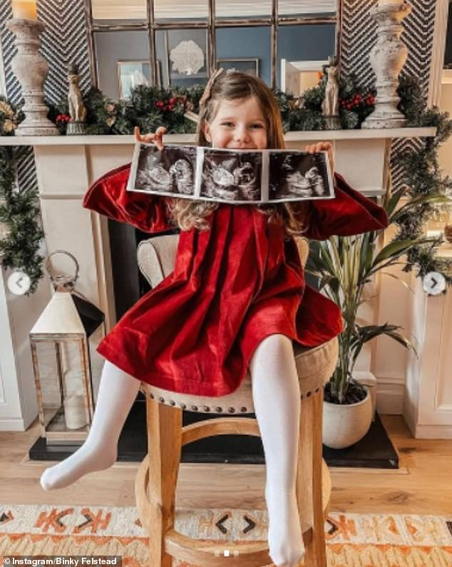 Adorable:Binky posted a stunning gallery of images as she debuted her growing baby bump, while standing with her partner and daughter India, three, who held up pictures of the ultrasound scan