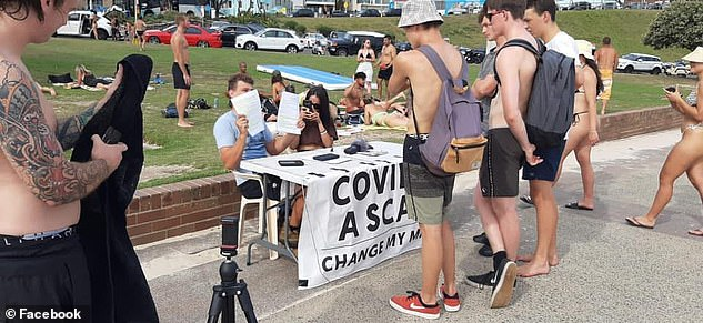 Mr Kavanagh has set up stalls at Bondi Beach (pictured: November 29) saying covid is 'a scam'. He argues the pandemic is being used to break down democracy and insert communism