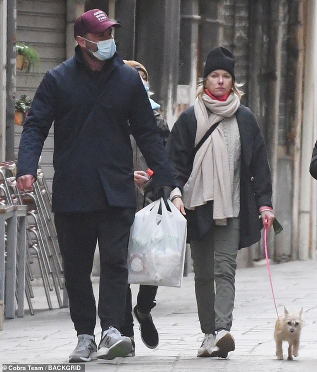 Family holiday: The amicable exes, 53 and 52, wrapped up warm on their winter vacation in Italy, and made sure to protect themselves from the novel coronavirus with face masks