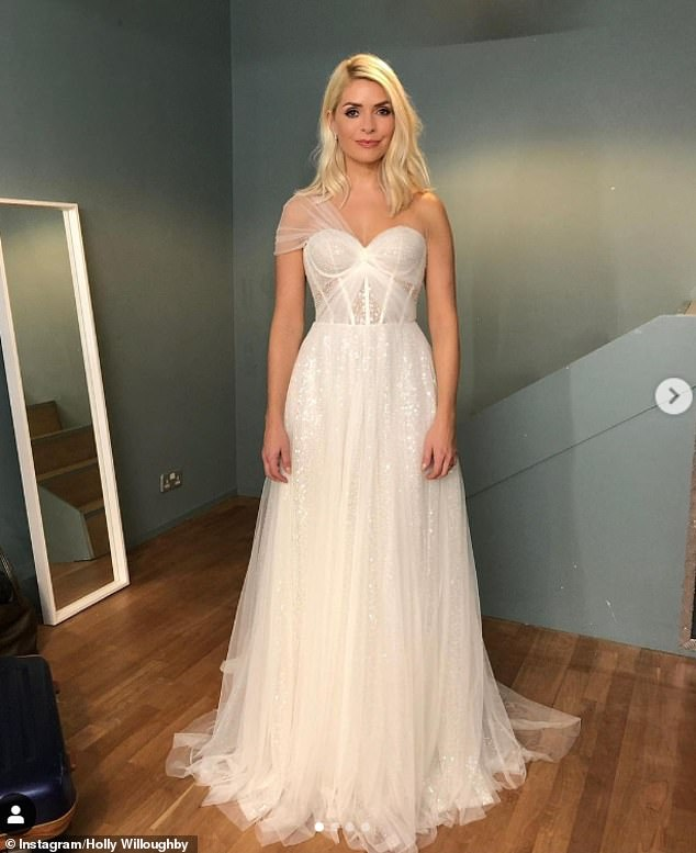 Wow:Holly Willoughby looked incredible as she posed in a fairytale-style gown in some elegant throwback snaps taken in October to promote the show