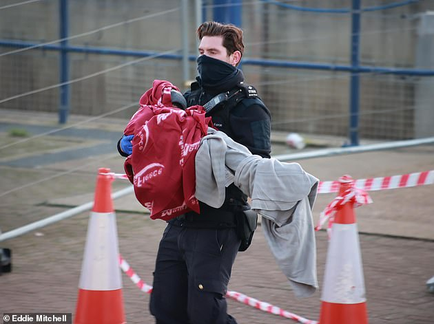 HM Coastguard confirmed earlier today to the BBC that it was 'coordinating a search and rescue response' after receiving a report that the 'with approximately 30 people on board was in difficulty'. Pictured: An officer carries a person to shore