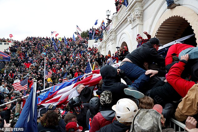 Dozens of House members were taken to the secure location after pro-Trump insurgents stormed the Capitol on Wednesday (pictured).  On Sunday, Capitol Hill attending physician Brian Moynihan announced that House lawmakers had been exposed to someone with COVID-19 while in the safe.