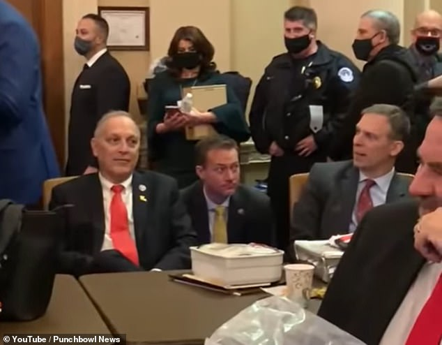 Representatives Andy Biggs, Michael Cloud and Scott Perry (seated, left to right) have been identified among Republican lawmakers who have refused to wear masks.