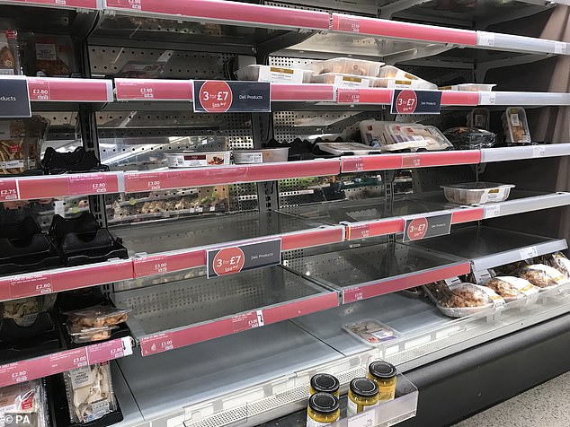 Empty shelves at a Marks & Spencer's store on the Lisburn Road in Belfast, with retailers 'experiencing some disruption after Brexit' and Marks and Spencer has temporarily withdrawn a small proportion of product lines to ensure its delivery lorries are not turned away at ports