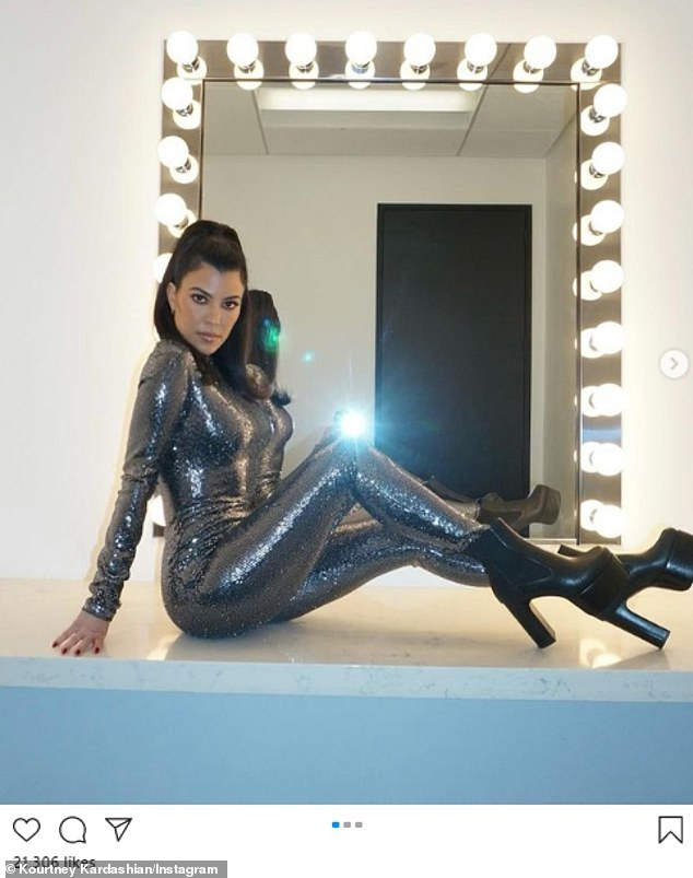 Curtain call: Kourtney Kardashian posted a set of photos to her Instagram account on Sunday featuring her dressed in a sparkling bodysuit and a pair of high-heeled boots