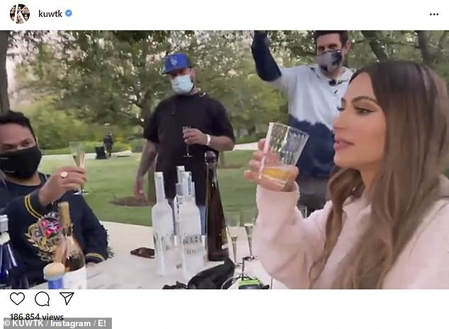 Raising a glass: A video was posted to the show's official Instagram account featuring Kim having a drink with some of the crew members