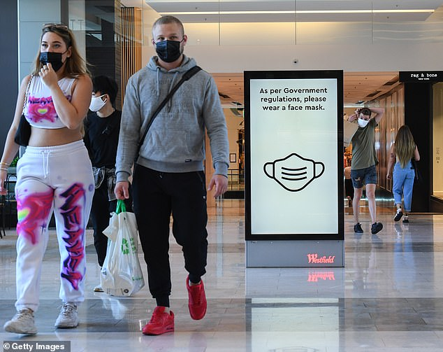 Pictured: Digital signs encourage customers to wear face masks at Westfield Bondi Junction in Sydney