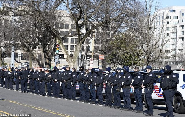 Capitol Hill police line up in preparation for the passing of the funeral hearse for slain Officer Brian Sicknick, who died in the rioting Wednesday