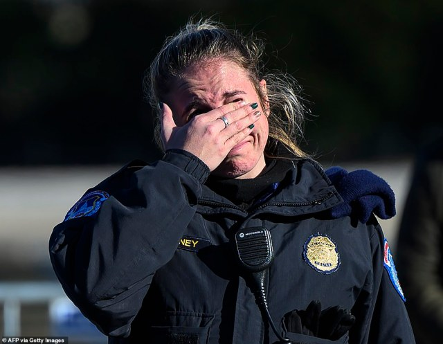 The pain is too much to bear for this police officer with the US Capital police after the casket with fallen police officer, Brian Sicknick, passed during a funeral procession in Washington, DC on Sunday