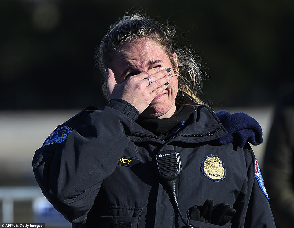 Cops shed tears as they line the streets of DC to salute Officer Brian Sicknick