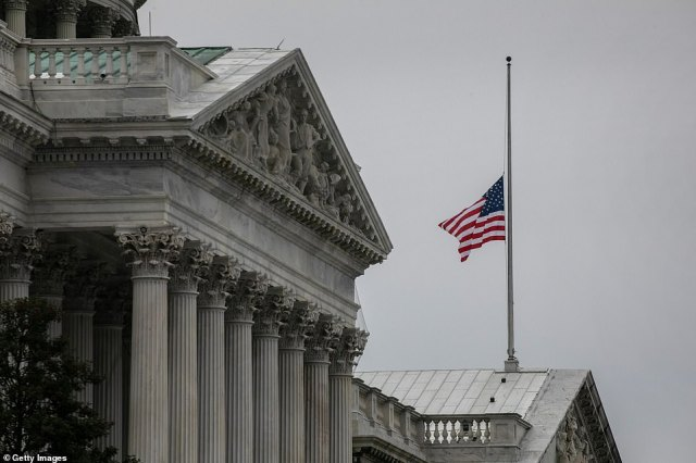 The American flag flies at half-staff at the U.S. Capitol after House Speaker Nancy Pelosi ordered the building's flags be lowered