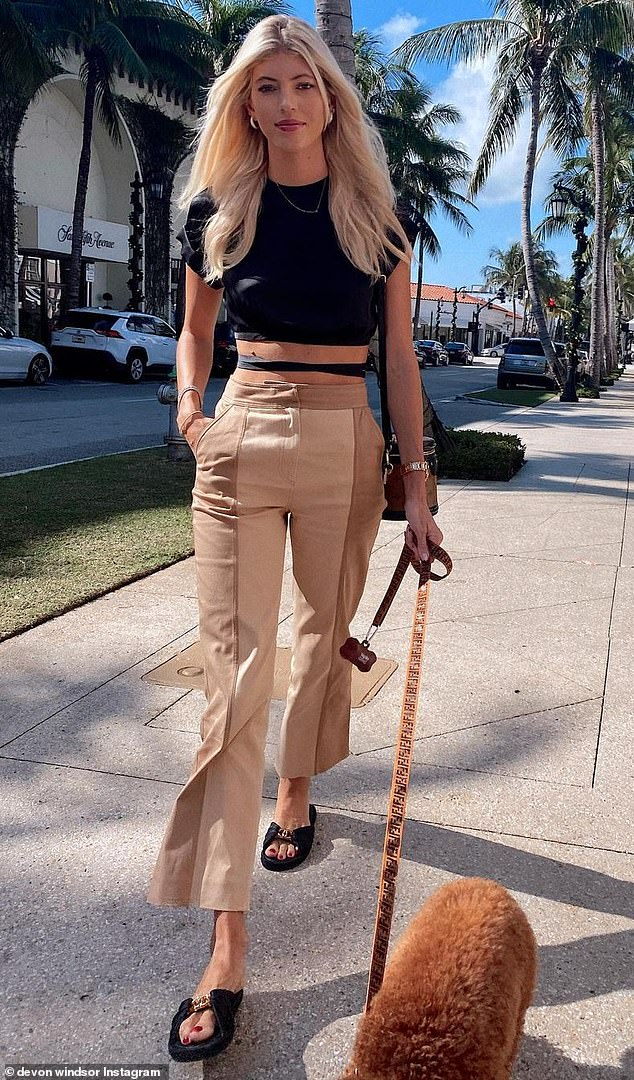 'Sunday stroll': Devon Windsor showed off her tiny waist in a series of Instagram pics on Sunday which showed her walking her dog in a designer ensemble