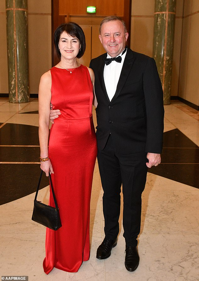 Opposition leader Anthony Albanese said it's about time those who spread hatred and lies on social media are de-platformed (pictured with wifeCarmel Tebbutt at the 2018Mid Winter Ball)