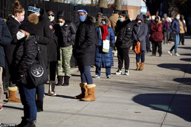 Long lines for vaccine: A view of people in line to receive the Moderna vaccine above at the South Bronx Educational Campus in New York City on Sunday