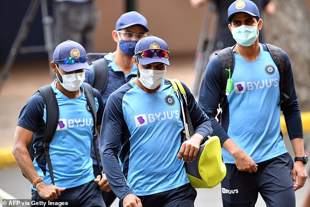 The fourth Test at Brisbane's Gabba will go ahead despite tensions escalating after Indian players reportedly refused to quarantine (pictured Indian players at training session in Sydney)